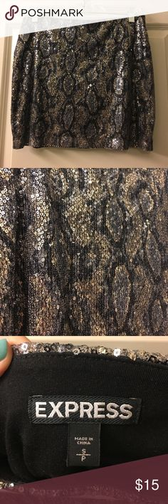 """Express Sequined Skirt Gently used, size small. Snake skin inspired, completely sequins. Lining is black """"silk"""" inspired to make it comfortable. Express Skirts Mini"""