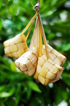 Ketupat - Indonesian rice cakes. Coconut fronds are woven into boxy shapes, partly filled with rice and boiled. It's eaten with savory foods, much like the way one would eat plain steamed rice. Eaten year round but especially at Lebaran, the day marking the end of the Muslim fasting month.