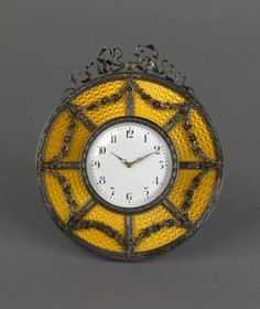A SILVER-GILT AND YELLOW GUILLOCHÉ ENAMEL DESK CLOCK   MARK OF FABERGÉ, MAKER'S MARK OF MIKHAIL PERKHIN IN CYRILLIC, ST PETERSBURG, 88 STANDARD