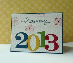 use a starburst paper background and individually colored numbers to ring in the new year on this handmade card