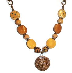 Check out Kazuri Bead Necklace. Ethnic. African Beads. Lion Focal. Lion Pendant. Animal. Statement Jewelry on riversedgecreations