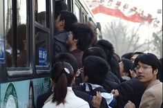 China's 'ant tribe' struggles to get onto a bus bound for downtown Beijing. Credit: Liu Yuxiang/China Features