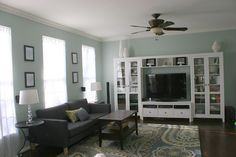 White, teal, green and gray family room/living room/great room