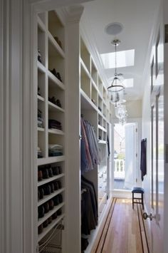 I love how this closet is not so huge you could sleep in it...but it still is organized nicely...