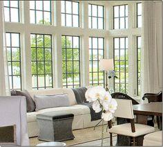 Great example! Bobby McAlpine:  Black windows + white molding around, softens it up