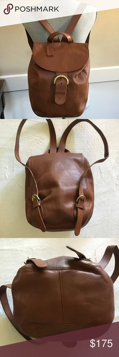 """Coach Vintage Whiskey Brown Backpack Vintage backpack that I purchased in the '90's. This bag is a gem!!  Whiskey Brown leather with brass hardware. Large interior with one large zip pocket inside. Front buckle closure and adjustable straps. Measures 10"""" Long  x 12"""" High x 6"""" Wide.  Made in the USA. Serial number K5H-4134. In excellent condition except for some pen marks on the inside of the top flap. Coach Bags Backpacks"""