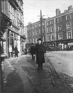 Vintage photograph, [Man in overcoat and bowler hat standing on St. Stephen's Green, near Grafton Street] Dublin Map, Dublin Hotels, Visit Dublin, Dublin Castle, Dublin City, Dublin Ireland, Castles In Ireland, Ireland Homes, Bowler Hat