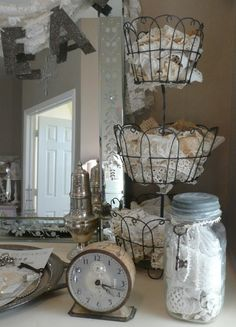 Love vintage decoration using antique lace, silver platter, keys, and especially  metal basket.
