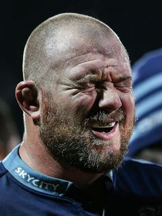 The Blues' Tony Woodcock grimaces in pain