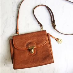 Vintage Authentic Dooney & Bourke Crossbody✨ Good condition, gentle wear. Some scuffs on the outside as shown, and pen marks/gentle scuffs/flaking from age on the inside (which obviously aren't visible when worn and happens often in some older bags). Super cute purse, great color! All weather leather that lasts! Definitely a purse with character. Dooney & Bourke Bags Crossbody Bags