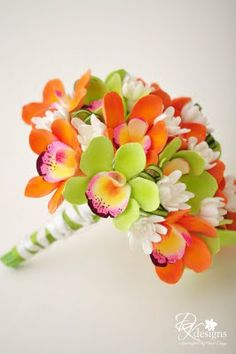 Cymbidiums orchids has this amazing green and orange colors. Love this Maui weddings bouquet