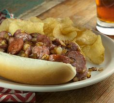 This might be the best summer recipe you'll ever try. Perfect for football party food, or really anytime, the Brazos Street Dog is a breed apart with a bark as loud as its bite! Traeger Recipes, Grilling Recipes, Slow Cooker Recipes, Beef Recipes, Cooking Recipes, Sausage Sandwiches, Meat Sandwich, Sandwich Recipes, Smoked Sausage Recipes