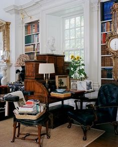 Oscar and annette de la renta's connecticut country house in kent with  a primary living space that serves as a living room, bedroom, dining room and library- sleeping, eating, reading, writing, living in one room