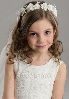 This lovely 24' long veil is accented with beautiful flower on the comb. The veil has a delicate design on the trim with small pears. Perfect accessory to complement First Holy Communion dress, flower girl dress, or any formal outfit. Comes as pictured.