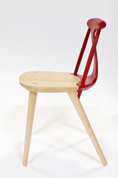 corliss chair designed by studio dunn combines wood and aluminum in elegant shape