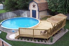"""View of 24' round 52"""" tall above ground pool that is sunk into the ground 24"""" to ease entry & exit of pool & provides more privacy, as it is not above the fence line."""