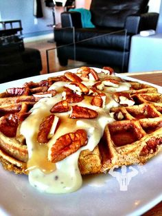Banana-Pecan Whole Grain Waffle with Vanilla Protein Creme.  OMG!  I used 1 tbsp sugar-free Maple Syrup.  Recipe (for batter): 1/3 cup whole grain flour, 1 ripe banana, 1 packet Stevia, 1 tbsp nonfat Greek yogurt, 1 egg, 1 egg white, 1/8 cup crushed pecans  Recipe for Protein Creme: Mix 1.5oz fat free creme cheese with 1 scoop Dymatize ISO 100 Whey protein and 2 tbsp Almond Milk.  Approx macros: 39g protein, 55g carbs (only 37g from grain), 14g fat (from pecans)