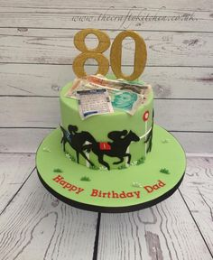 Made for a chaps 80th birthday, who loves nothing better than a little flutter on the Gee Gees! The horses are hand cut from gumpaste, the money and betting slip are edible.