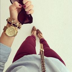 Cranberry colored pants // gold jewelry // leopard