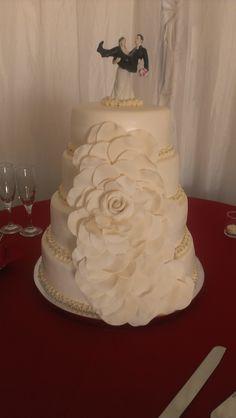 champagne cake w/ custard, red velvet w/ cream cheese, chocolate w/ chocolate mousse, vanilla w/ raspberry and marshmellow fondant
