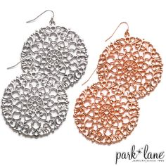 Rhodium silvertone or rose gold filigree disks fashion these dramatic and airy fishhook earrings.