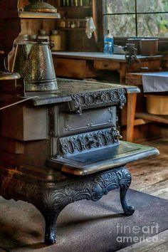 Old Farm Kitchen and Wood Stove; isn't that stove beautiful.