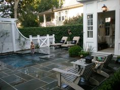 small pool idea- just enough water to justify putting on a bathing suit for an afternoon of lounging, reading, ice tea sipping