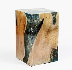 I am quite fascinated by these cracked resin and wood side tables by Andrianna Shamaris.