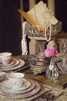 I like the idea of a non-flower centerpiece. Or maybe something very special for specific tables. -Vintage Tablescape vintage wedding ideas