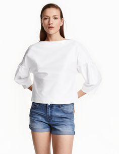 Check this out! Wide, straight-cut top in ribbed jersey with a boat neck, dropped shoulders, and 3/4-length ruffled sleeves. - Visit hm.com to see more.
