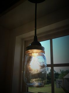 Mason jar pendent light for over the sink.