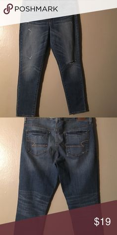 AEO jeans Med. blue wash with ripped knee on one leg ... Little destructed detail.. Super skinny leg size 12 Regular American Eagle Outfitters Jeans Skinny