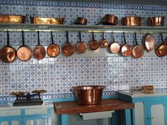 {Monet's kitchen, Giverny} the copper pots were so perfect all in a row.