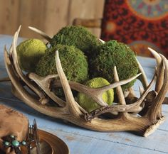 antler centerpiece - This, filled with an offering of fruits or sweets -- whatever's in season.  I don't even care if it's at the wedding, I want it at home.