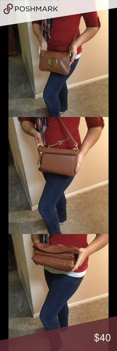 "Warm Brown Vegan Leather Cross Body A nice cross body that feels likes and looks like smooth leather.  Has three main compartments and two small ones.  Opens up to 6"" if need be.  Lining is beautiful and very clean.  Top closes with a gold tone zipper.  No wear. Bags Crossbody Bags"