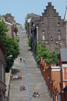 Liège, Belgium - Montagne de Bueren - Steps of the Montagne du Bueren  The climb up the 374 steps of the Montagne du Bueren to the Parc de la Citadelle (158m/518ft) is rewarded with a fine view of the city. The park incorporates the grounds and bastions of the 18th C. citadel (now a barracks). Either return the same way or continue along the path already started, which finally leads back down to the church of Saint-Barthélemy.