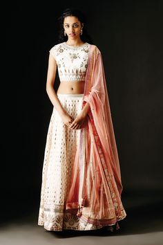 <p>Featuring a stunning trousseau of a lehenga, choli and dupatta, in blush with shimmering embroidery all over. Wear it with chandi balis, a mang tika and a set of bangles to be the queen of the evening.</p><p><strong>COMPOSITION: </strong>Lehenga-Cotton Silk.</p><p>Choli-Raw Silk.</p><p>Dupatta-Net.</p><p><strong>DISCLAIMER: </strong>We require 3-6 weeks for the dispatch, as the product is customized.</p>