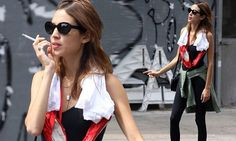 Alexa Chung drapes red ballet pumps around her neck post-work-out