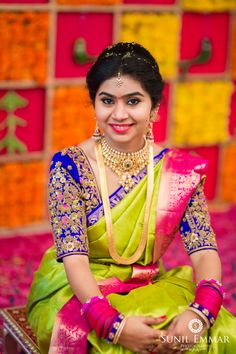 South Indian bride. Gold Indian bridal jewelry.Temple jewelry. Jhumkis. Bright green silk kanchipuram sari with contrast embroidered blue blouse.braid with fresh jasmine flowers. Tamil bride. Telugu bride. Kannada bride. Hindu bride. Malayalee bride.Kerala bride.South Indian wedding.
