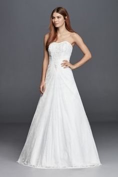 Imagine you're walking down the aisle and all eyes are on you.Elegantly,you grace the aisle with an allover lace wedding dress featuring an a-line silhouette, beaded bodice and sweetheart neckline. Find all these details and more in this timelessdesign.  David's Bridal Collection.  Check your local stores for availability.  Chapel train. Fully lined. Back zipper. Imported. Dry clean only. Cherish your wedding dress forever with our Wedding Gown Preservation Kit.