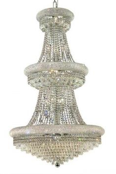 Adele - Large Hanging Fixture (32 Light Modern Grand Crystal Chandelier) - 1531G30. This Adele - Large Hanging Fixture  (32 Light Modern Grand Crystal Chandelier), is unmatched in its quality craftsmanship.  This elegant lighting fixtures, comes in a variety of finishes, crystal trims (including Heirloom Grandcut, Heirloom Handcut, Swarovski Elements & Swarovski Spectra) and crystal colors.  Finish, crystal trim and crystal color are all dependent on the model (check options). About The…