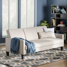 This elegant white sofa that can stand up to any type of decor. | 22 Cheap Sofas That Look Like A Million Bucks