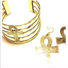 """Return Of The Ankh --- Brass Cuff & Earring Set Return Of The Ankh --- Brass Bracelet Cuff & Earring Set --- Earrings are etched on both sides --- 2.2"""" x  1.4"""" --- lightweight --- The cuff is adjustable --- 1.5"""" at tallest point, 1"""" at the most narrow point --- The Ankh is the Ancient Egyptian hieroglyph for Life --- Thank you for visiting my boutique, and please feel free to ask any questions ❤️ --- Boutique Jewelry Bracelets"""