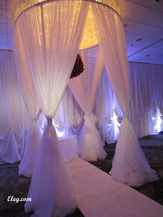 Round wedding chuppah,centered under a chandelier