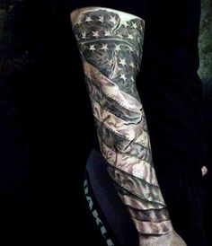 Black Sleeve Man With American Flags Tattoos
