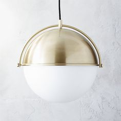 Shop globe pendant light.   Designed by Mark Daniel of Slate Design, the globe pendant takes it's cue from vintage nautical instruments.  Beautiful brushed brass tops a frosted glass hemisphere shade distributing and diffusing light for a soft warm glow.