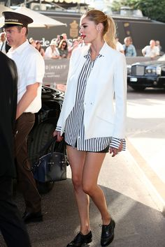 For dash of polish, throw a white blazer over a crisp, classic striped button up and run with it.   - MarieClaire.com