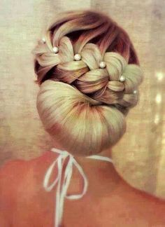 Very different but stunning also for a wedding style up-do.