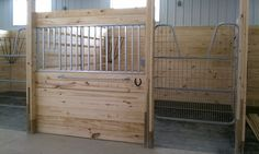 ahhh I want a horse barn someday with gorgeous stalls like this!