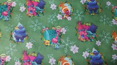 Trolls Character Toss Green Cotton Fabric Sold by the Yard  Content: 100% Cotton Care: Machine Wash Cold. No Bleach, Tumble Low, Warm Iron if Needed. Width: 44  Fabric is great for clothing, pillow cases, and much more! The possibilities are endless with this fabric! It is easy to sew with and has easy care.  Multiple yards are available. If more than one yard is purchased it will be shipped as one whole piece.
